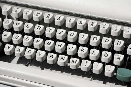 Aged mechanical typewriter, diagonal image formation. photo