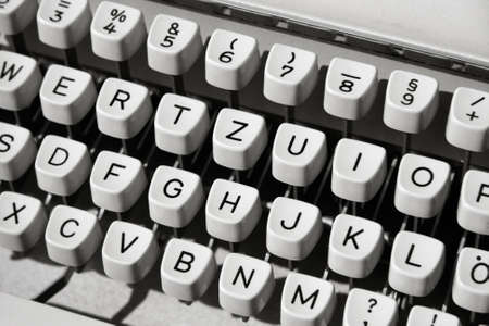 Buttons of an old mechanical typewriter, close-up with low depth.