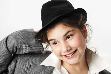 Funny teenage girl with hat and suit Stock Photo