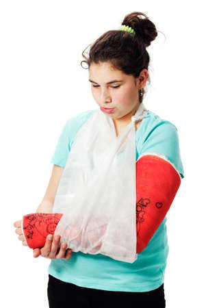 cast: Girl with plaster cast pouting. Stock Photo
