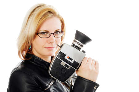 Young woman holding an old movie camera. Studio shot against a white background.