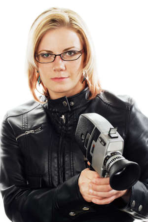old leather: Young woman with leather jacket  holding an old movie camera. Stock Photo