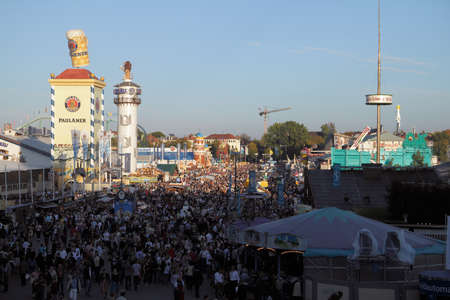 Munich, Germany - October 03, 2010: Panoramic view at at the Oktoberfest with crowds of visitors. In 2010 it is the 200-year anniversary. Editorial