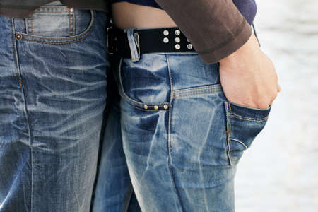 jeans girl: Couple in love, two young people, boy and girl, close together in Jeans. Stock Photo