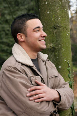 likable: Smiling man in Profile, autumnal portrait of a young man.