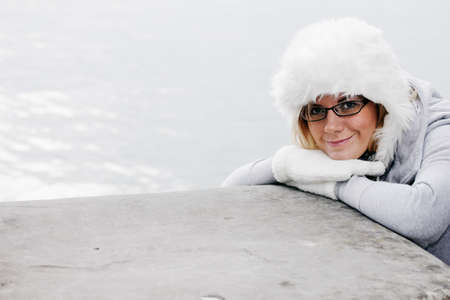 Nice young woman in warm winter outfit and a warm wool cap. Stock Photo - 10837131