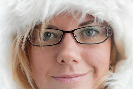 Young woman with warm fur cap for the winter, close-up photo