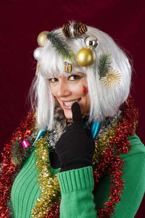 Seductive Christmas woman with the Finger at her mouth. photo