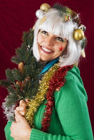 przewidywanie: Przewidywanie Bożego Narodzenia - błogosławiony patrząc kobieta jodła oddział.