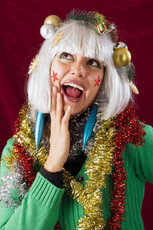 Christmas decorated woman with open mouth looking surprised. photo