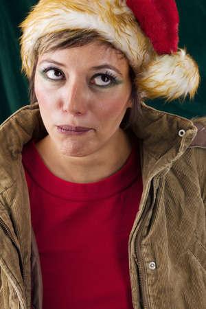 pom pom: Funny female Santa. Studio shot against a dark green background.