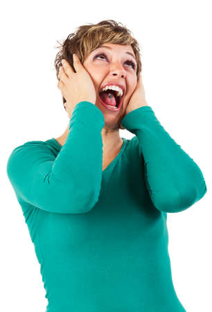 Young woman screaming. Isolated studio shot against a white background with copy space. photo