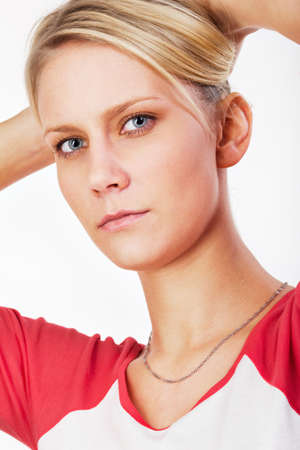 Young blonde woman checks her hair, Portrait. photo