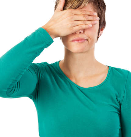 Young woman covering her eyes with her hand. photo