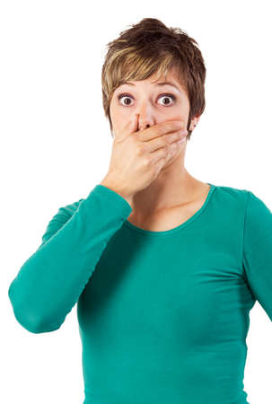 covering eyes: Shocked woman in green sweatshirt covering her mouth. Stock Photo