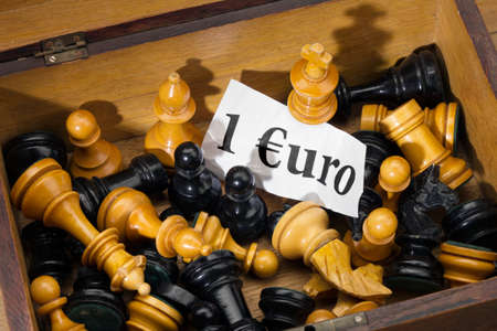 Chess and Euro - close up of chessmen as a detail at the flea market  photo