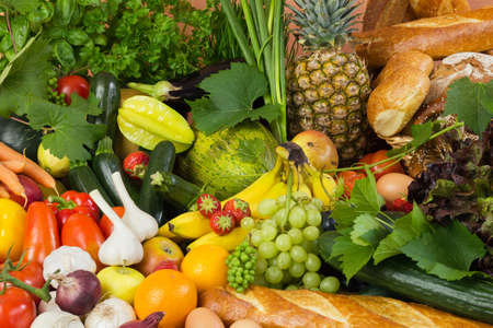 biologic: Plenty of fruit, vegetables and bread, herbs and bakery like tomatoes, zucchini, melons and basil arranged in a large group, natural studio shot for healthy food