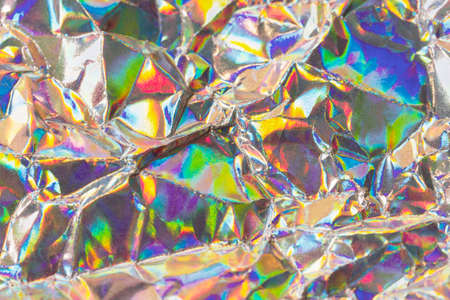 Detail close up of wrinkled metallic paper as a colorful fantasy background image in soft colors with focus at the center Stock Photo - 21766087