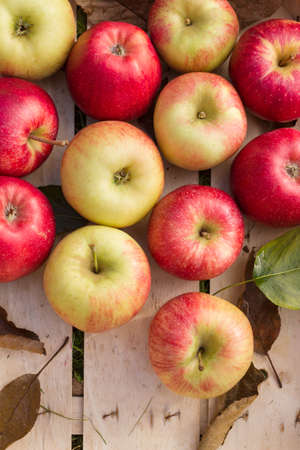 Fresh organic apples arranged in a wooden box as a natural still life for healthy and vegetarian food Stock Photo
