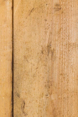 Weathered timber with a split at the edge as a natural wooden background Stock Photo