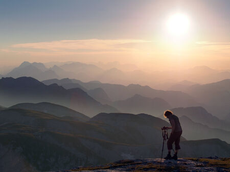 Photographer shooting the beautiful landscape of the Hochschwab mountains photo