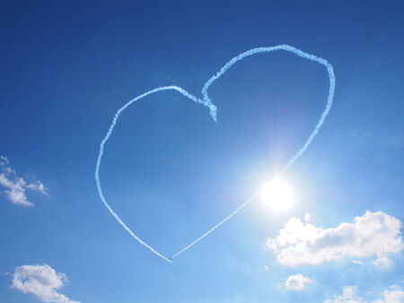 Heart shape in the sky made from the planes traces photo