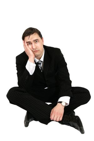 sad young businessman sitting on the floor photo