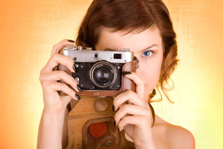 glamorous girl holding a camera Stock Photo - 1961785