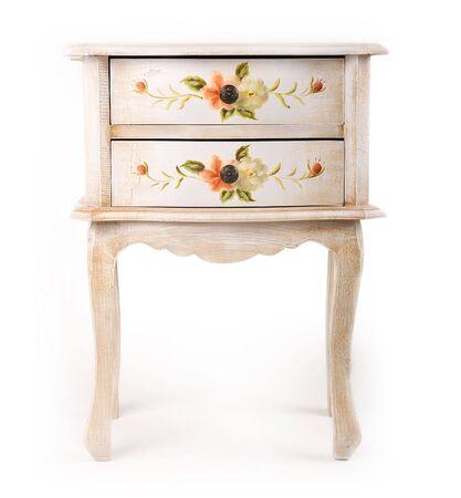 stylish patterned wooden cabinet over white background photo