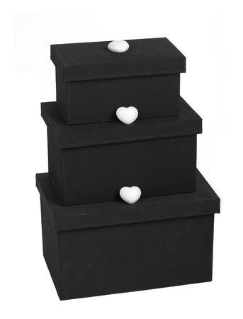 three gift boxes: tres cajas de regalo con el coraz�n m�s de fondo blanco Foto de archivo