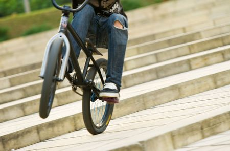 young biker riding a bmx bicycle Stock Photo - 5737118
