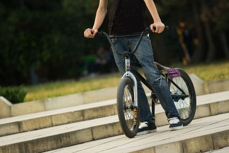 young biker riding a bmx bicycle Stock Photo - 5737074