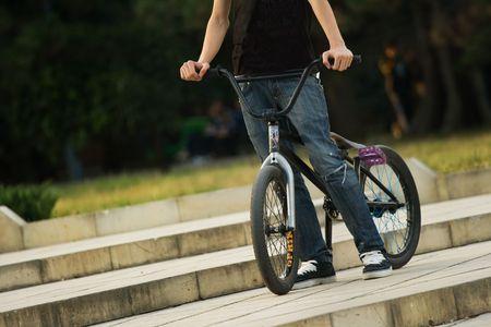 young biker riding a bmx bicycle Stock Photo - 5737074