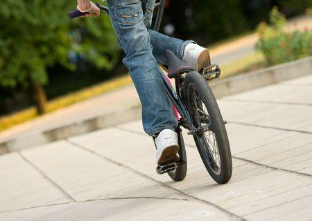young biker riding a bmx bicycle photo