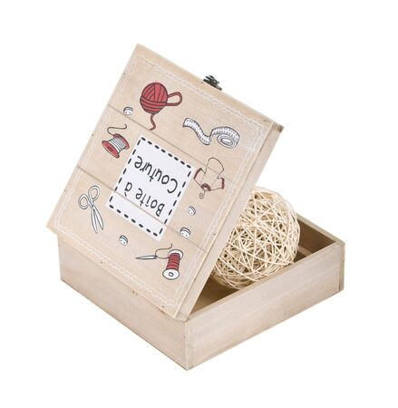 sewing box: open wooden sewing box with clew in it