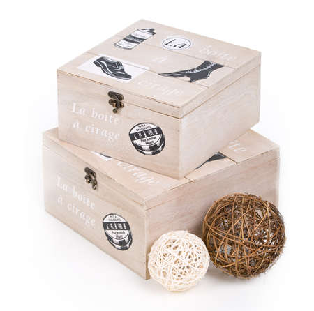 fancy wooden sewing boxes with some clews by them photo