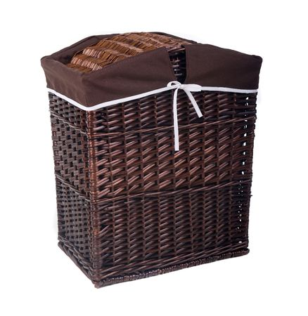 fancy wooden laundry basket over white background      photo