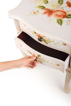 stylish patterned wooden cabinet with mans hand opening it photo