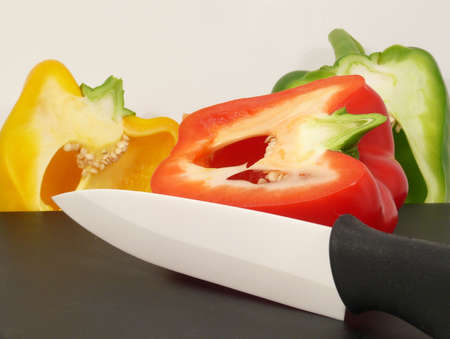 Extremely sharp knife cut in vegetables Imagens