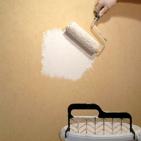 Rolling paint on wallpaper photo