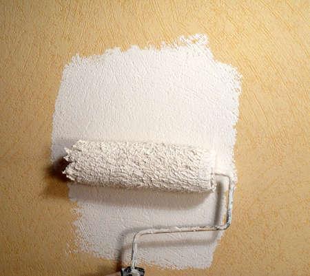 Rolling paint on wallpaper