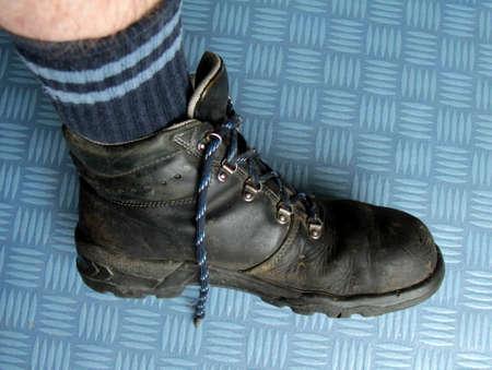 steel toe boots: Men in the leg work shoe Stock Photo