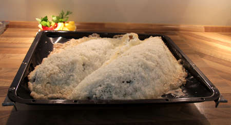 Food fish in salt crust photo