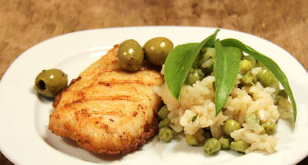 menue: hake menue with pear risotto Stock Photo