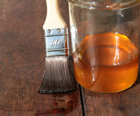 linseed oil: Wood protection by linseed oil in the outside sector Stock Photo