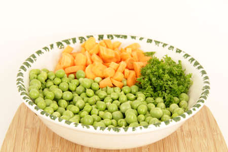 carrots, peas and parsley photo