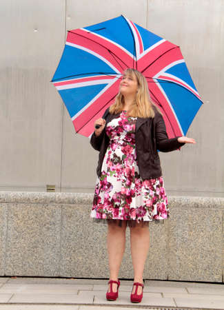 Young plus-size model with rain umbrella