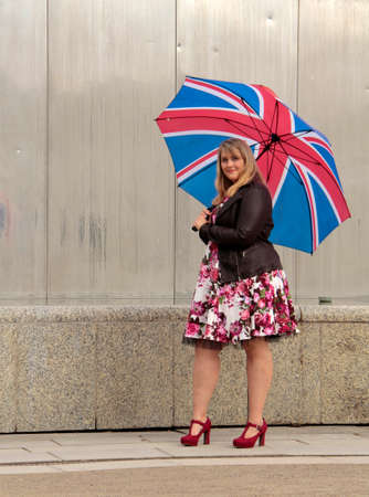flowerpower: Young plus-size model with rain umbrella