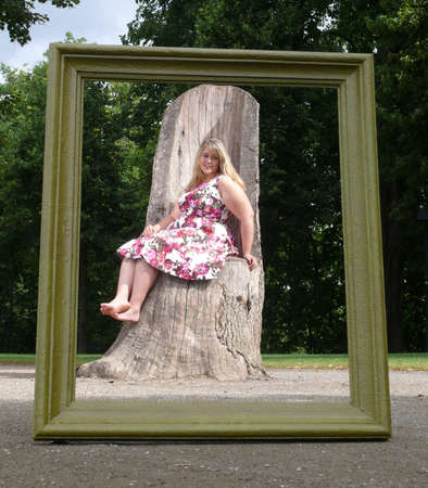 corpulent: young plus size model and the wooden photo frame