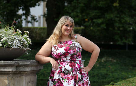 Young plus-size model in summer dress